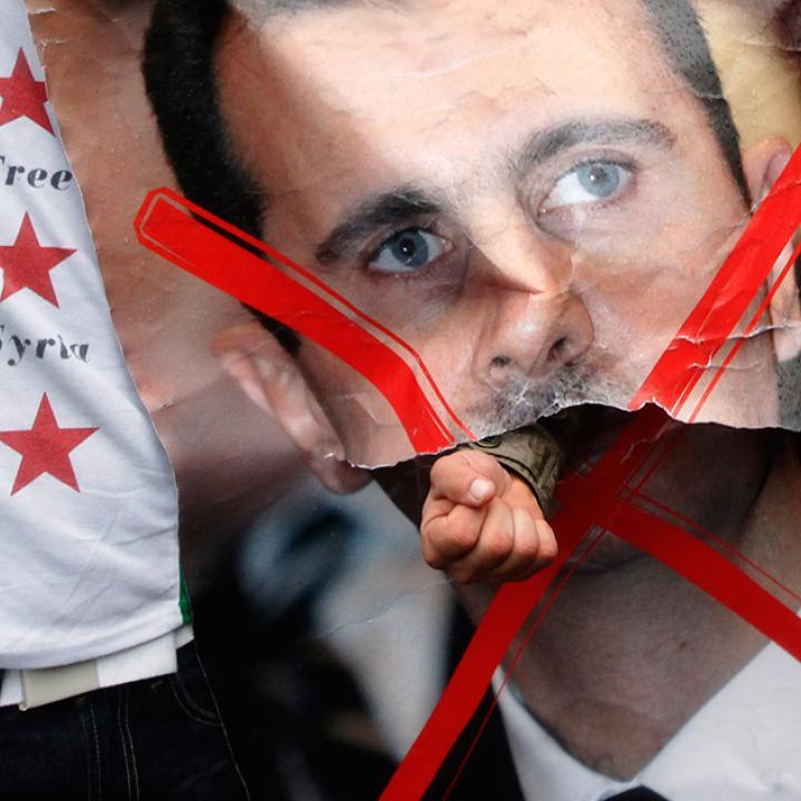 Plakat z wizerunkiem Asada.